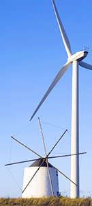 Image:  Old Greek windmill next to modern wind turbine