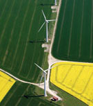 Image:  Aerial view of wind turbines along edges of arable fields