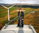 Image:  Engineer standing on wind turbine nacelle