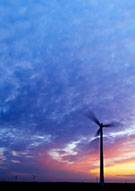 Image:  Silhouette of wind turbine against sunset sky