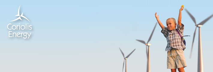 Image:  Boy standing in front of three wind turbines