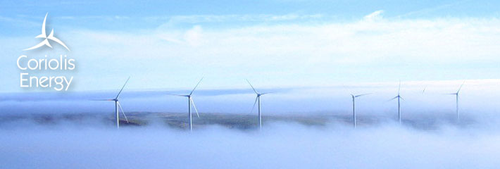 Image: Group of six wind turbines in a foggy landscape