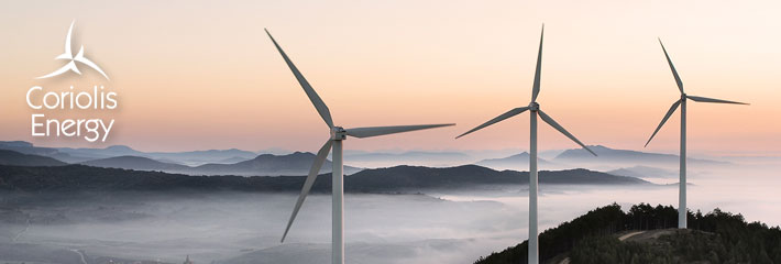 Image:  Three wind turbines on a mountain top at dawn